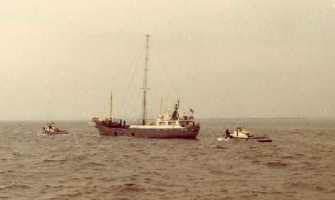 Magda maria being towed into port by police