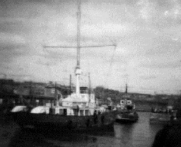 Comet being towed into Methil Harbour